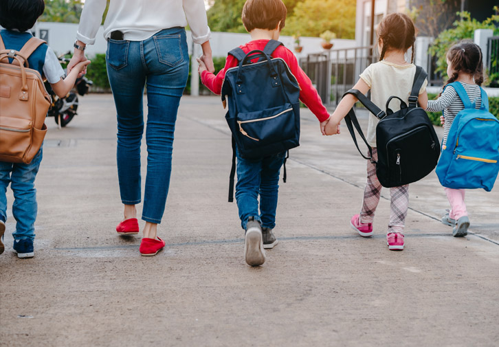 kids walking with mom at back-to-school night